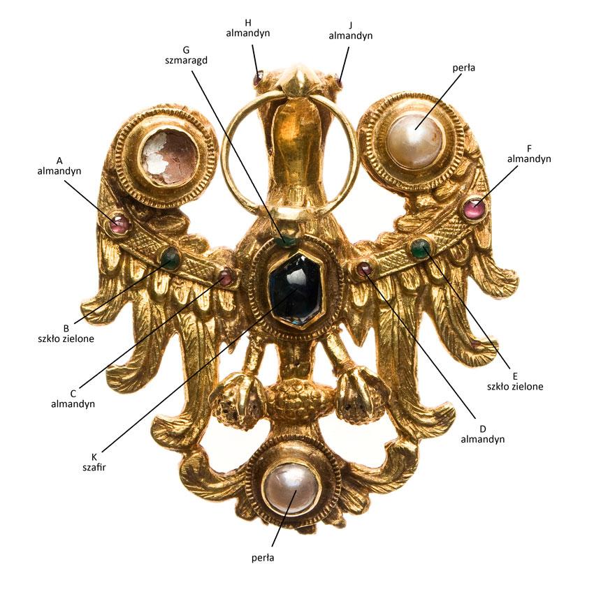 złoty orzeł z wyszczególnionymi ozdobnymi kamieniami