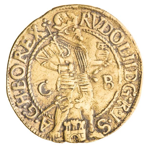złota moneta z postacią