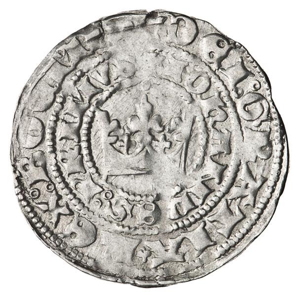 srebrna moneta zkoroną