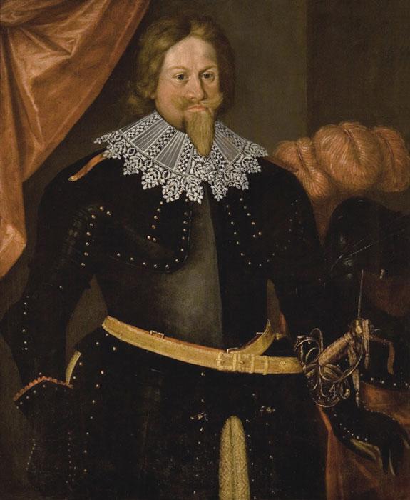 brodaty mężczyzna wczarnym ubraniu zbialym koronkowym kołnierzem
