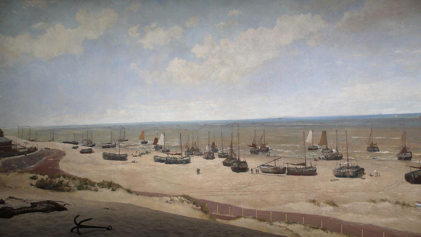 fragment panoramy zkrajobrazem piaszczystej plaży istatkami nawodzie